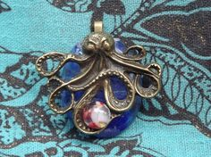 Octopus fused glass pendant by PiecesofhomeMosaics on Etsy, $21.00
