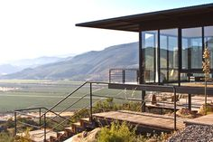 """Region: Valle de Guadalupe  Where to stay: Encuentro Guadalupe Antiresort Encuentro is the ultimate """"glamping"""" getaway in the Valle. Guests can book one of 20 stand-alone, one-room bungalows that dot the hilly landscape, which were specifically built to respect the natural surroundings. A gourmet restaurant (pictured here), a pool, and a winery complete the grounds."""