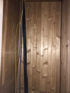 This photo shows the brand new cedar wall before the electricians started. Note there is no damage on the left side and the screw on the top left panel goes into the wall. Cedar Walls, Electrical Problems, House Projects, Seattle, Ceiling, Note, Flooring, Home Decor, Ceilings