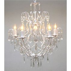 @Overstock.com - Regent 5-light White Iron Chandelier - Light your dining room in style with this elegant iron chandelier with five lights. The intricately curved iron with its white finish combines with crystal accents to create an eye-catching piece that is sure to intrigue your guests.  http://www.overstock.com/Home-Garden/Regent-5-light-White-Iron-Chandelier/5518976/product.html?CID=214117 $144.99