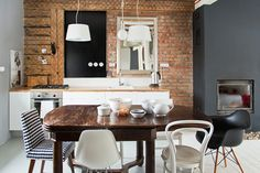 eclectic eat-in kitchen, love it... I need to find the perfect table!!