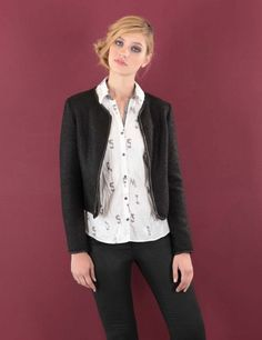 """Chic little jacket with faux leather trim. """"My Little Favourite Jacket"""" is printed inside. Polyester / Acrylic with 100% Cotton lining. Black Size 10, Cream Size 14 £89 Worn over 100% Crinkle Cotton shirt in cream with plum and grey detail. It comes with it's own drawstring storage bag. Just wash, dry, twist and store. Shake out to wear. Simple it may be but there is no reduction in quality. Size 14 only £63."""