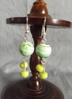 SOLD!!! Beautiful Silver tone and Glass bead earrings.                                             (Approximately 4cm long and 1cm wide)
