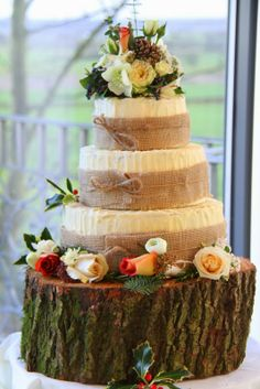 The Wedding Cake was dressed with posies and corsages of fresh flowers