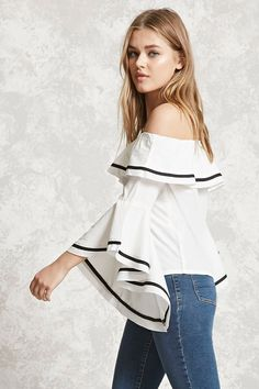 A woven top featuring an off-the-shoulder neckline, a flounce layer, long trumpet sleeves, contrast stripes, and a boxy silhouette.