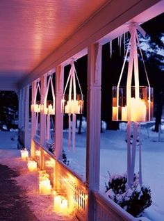 I love this look for winter. This could be very cool for a Christmas party. Basically, they took plexiglass boxes put candles in them and hung them with ribbon. So elegant… {brides.com}