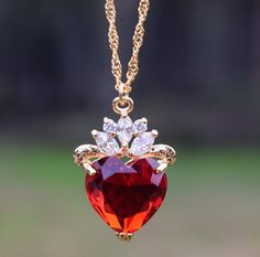 This is so pretty!  I immediately thought of the Queen of Hearts even before knowing the necklace was inspired by Alice in Wonderland.
