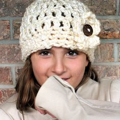 Make this Chunky Flower Button Hat with my FREE crochet Pattern and stay Cozy Warm This Winter. Free Crochet Beanie from Rescued Paw Designs.