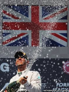 Lewis Hamilton of Great Britain and Mercedes GP celebrates on the podium after winning the Hungarian Formula One Grand Prix F1 Lewis Hamilton, Lewis Hamilton Formula 1, Mercedes Gp, F1 Racing, Drag Racing, British Sports, Formula 1 Car, Racing Events, Thing 1