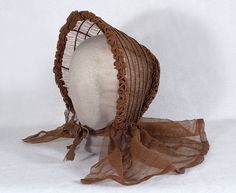 Caned gauze bonnet, c.1845. What a miracle that this rare and delicate bonnet has survived at all! The sheer gauze is more like a whisper than a fabric. it w