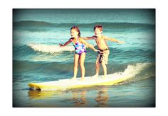 Groms-Girl With A Surfboard