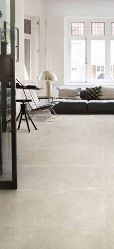 Embrace luxurious #concrete #floors with a #creamy, #contemporary #stone #tile from Unicom Starker. #home #design #interior #indoor #living #room #flooring