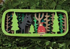 My Little red in the deep dark woods brooch is laser cut from an original illustration by myself. It depicts Little Red Riding Hood and the wolf in the
