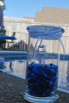 #diamondcandles Jar Reuse Idea: #summerjarreusecontest  - Cleaned my #diamondcandle jar, filled it with blue glass stones, added an eco friendly flameless candle and ribbon.  Excellent ambiance for around the pool.