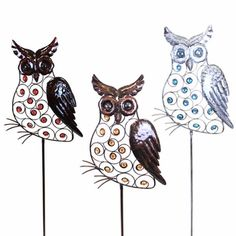 Metal owl stakes, available at Garden Fun...oh, how I want these!