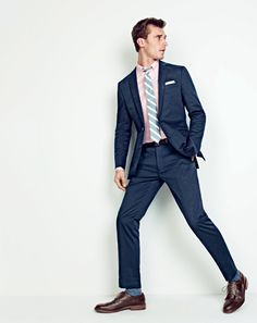 J.Crew men's Ludlow suit jacket in Italian stretch chino, Ludlow cotton oxford shirt, Ludlow suit pant in Italian stretch chino, linen-cotton tie in textured stripe, sterling-silver bobby pin tie bar, English linen pocket square, medium-dot cotton socks and Ludlow wing tips.