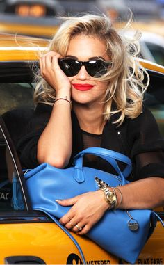 Rita Ora looks super chic with a pop of red lipstick.