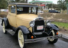 """1929 Model A Ford Coupe...grandpa's was olive green...(Mom's got it now). Us kids would fight over who got to ride in the rumble seat and hit the """"oooga-oooga"""" horn. Great Memories!!!"""