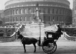A hansom cab parked in front of the Royal Albert Hall, London, 1904.