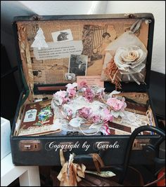 OLD SUITCASES MAKE FOR BEAUTIFUL AS WELL AS FUNCTIONALDISPLAYS..
