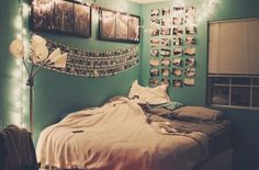 The bed is kinda boring but i LOVE the rows of pictures!!
