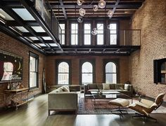 Living area with lots of exposed brick sits beneath a metal catwalk in this loft in New York City. 993 area with lots of exposed brick sits beneath a metal catwalk in this loft in New York City. Loft Interiors, Industrial Interiors, Industrial House, Modern Industrial, Industrial Apartment, Industrial Restaurant, Industrial Shelving, Industrial Furniture, Industrial Bathroom