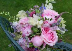 Summer wedding brides bouquet with David Austin roses and cottage garden flowers.