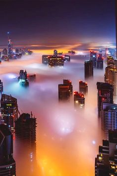 A city in the clouds? No ...it's Dubai in a sea of fog