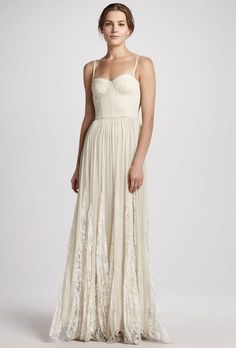 "Brides.com: Wedding Dresses We Love For Under $1,000. For a boho bride who craves a dash of sex-appeal, the bustier bodice on this lightweight, pleated maxi dress will up the va va voom factor.  ""Geneva"" bustier pleated maxi wedding dress, $597, Alice + Olivia available at Neiman Marcus  See more spaghetti strap wedding dresses."