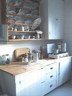 Love the open dish rack and the wooden counter tops.