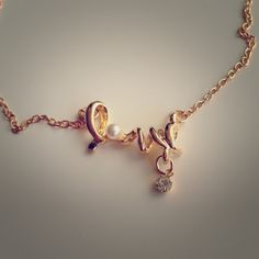 """LOVE ❤ gold necklace! Brand new gold color Love necklace with pearl for the """"O"""" and diamond under the """"V"""". Super cute and brand new! Measures about 8.5""""! Jewelry Necklaces"""