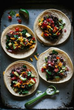 Black Bean and Quinoa Tacos I An easy to make taco recipe made with mixing mashed black beans with quinoa and topping it off with pico de gallo and yogurt sauce.