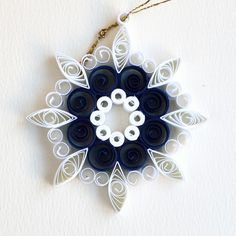 https://flic.kr/p/Bv51hN | 8 point open circle dark blue and white quilled snowflake