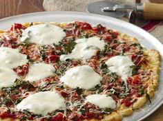 #Glutenfree Margherita Pizza. Less is more when it comes to pizza--simple sauce with minimal toppings.
