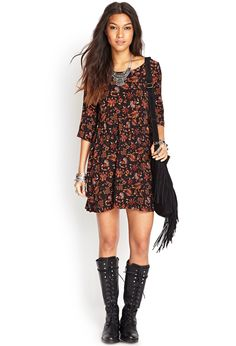 I. Love. This. Floral Babydoll dress tunic. Feminine grunge. Tall lace up combat boots. I'd add thigh socks with mine.