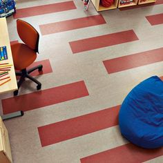Marmoleum plank design in a beige and red- diagonals