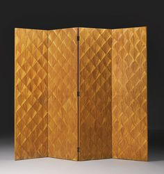 Jean-Michel Frank, FOUR-PANEL SCREEN, each panel incised with roman numerals to the underside straw marquetry, circa 1925, produced by Adolphe Chanaux, Paris.