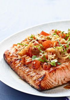 Perfect Grilled Bruschetta Salmon — No need for a baguette to make this tasty bruschetta! In this recipe, chopped tomatoes, garlic and basil top a perfectly grilled salmon fillet.