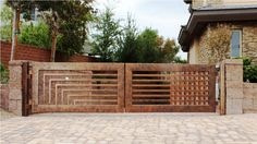 Image of: Wrought Iron Contemporary Driveway Gates
