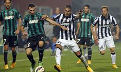 Juventus\' Pereyra and Sassuolo's Longhi fight for the ball during their Italian Serie A soccer match at the Mapei stadium in Reggio Emilia