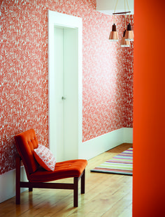 Harlequin's 'People' wallpaper is both bold and bright in this rich orange palette! It features abstract silhouettes of crowds of people.