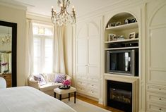 Fireplace, TV, chandelier, closet millwork - french, paris, bedroom, apartment, townhouse