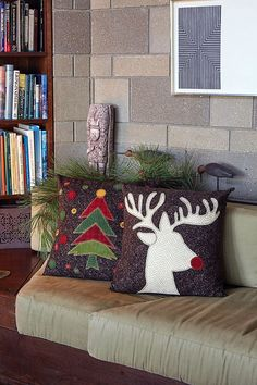 Looking for a fall holiday home decorating project? This is it! An easy-to-make pair of throw pillows combine cute appliques with luscious wool fabrics.