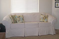 make your own couch slip cover. If your couch is an odd shape, like mine! then this is the tutorial and pattern for you. Any couch can be covered it just takes time and patience. I love my pottery barn inspired couch slip cover! Diy Sofa Cover, Sofa Covers, Couch Makeover, Furniture Makeover, Furniture Ideas, Pottery Barn Slipcover Sofa, Couch Slipcover, Old Sofa, Diy Couch