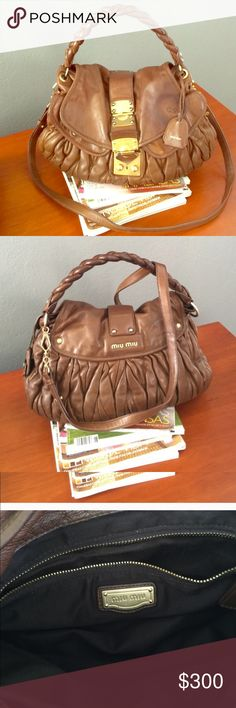 Mui Mui Prada brown purse 😍😍😍 Reposh Mui Mui brown leather authentic Prada bag.. Has a little stain on the front but other than that it's beautiful but I really need a summer color purse and I don't use this one.. It needs someone that will love it.. Open to offers Mui mui Bags Hobos