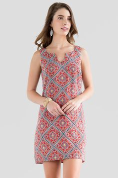 This simple shift boasts a bold print! The Seersha Printed Dress is  fashioned in a