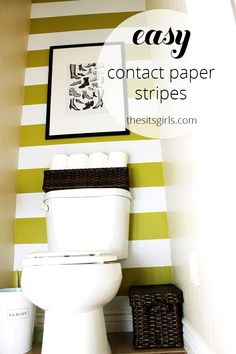 Decorating a small bathroom has never been this easy! Use contact paper to create stripes on your wall. This is perfect for renters who can't paint.