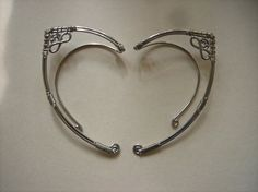 Pair of Elf Ear Wraps by catchalljewelry on Etsy- these would be very cute for a Ren faire costume