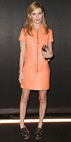 The actress picks a utilitarian mini in orange, the color of the moment, and platform clogs (both Coach) for the line's Backstage Rodeo Drive event in Beverly Hills.  (Dec 2014)