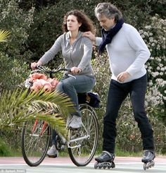 Andrea Bocelli rollerblading with his wife... fearless ... awe inspiring.  That's great!  And his singing ain't too bad either!